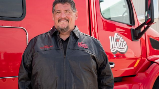 Wylie 2021 OTR Driver of the Year outside of truck.